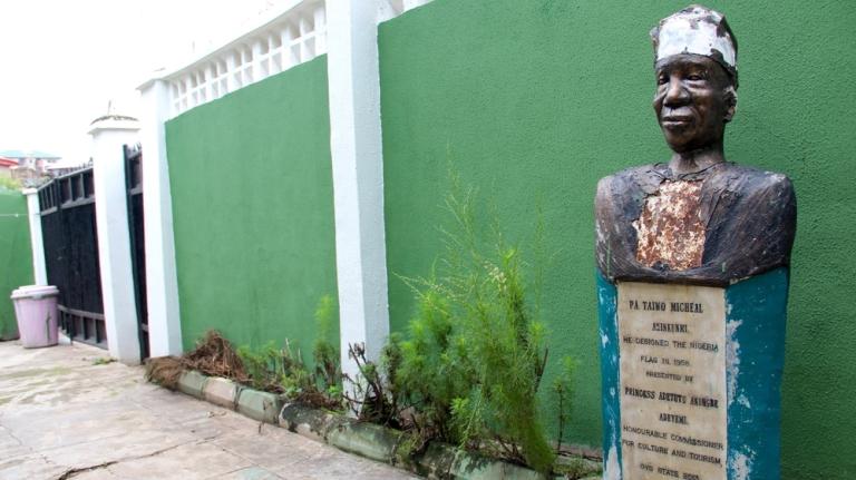 A statue commemorates Michael Taiwo Akinkunmi [Femke van Zeijl/Al Jazeera]